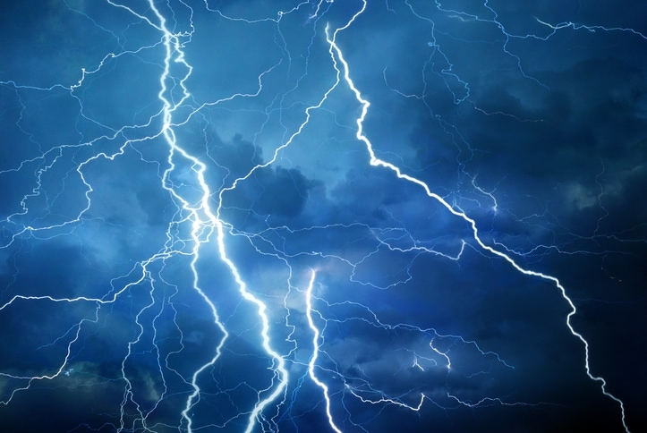 lightening in a storm representing how to protect your ac from storms