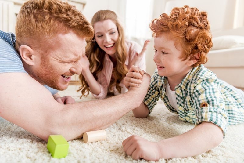 Family arm wrestling over air conditioner vs. heat pump cooling services in Athens