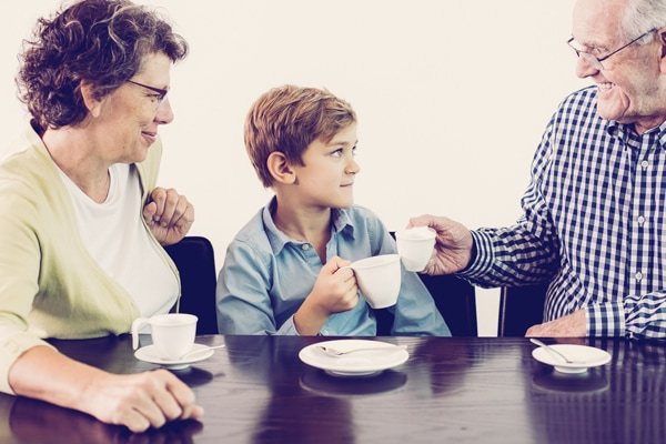 Closeup of little boy and his grandparents drinking hot chocolate or tea. , the Basics of Winter Indoor Air Quality