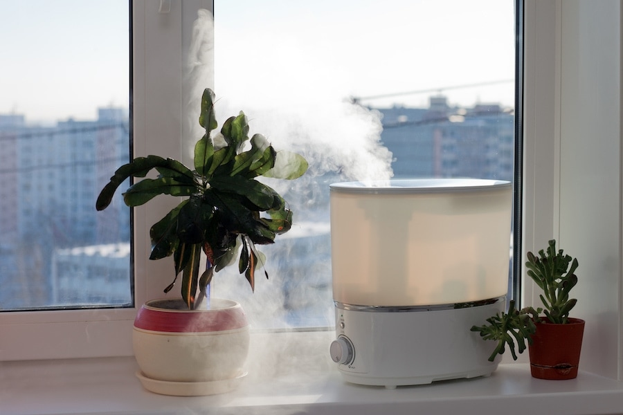 A humidifier by a window inside a home to show you what IAQ accessories can help keep your healthy.