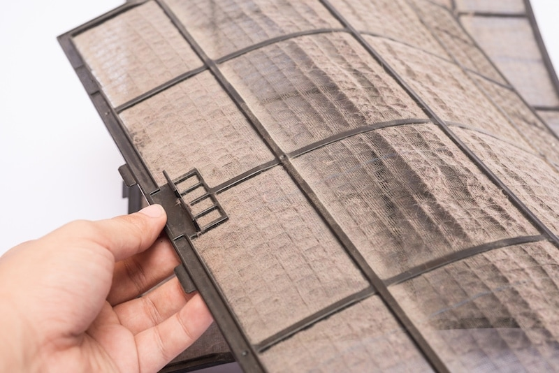 dirty air conditioner filter hand pick up