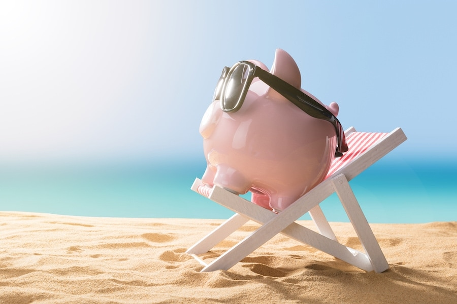 Piggy bank on the beach representing the financing options for how you can afford a new AC system and other HVAC equipment.